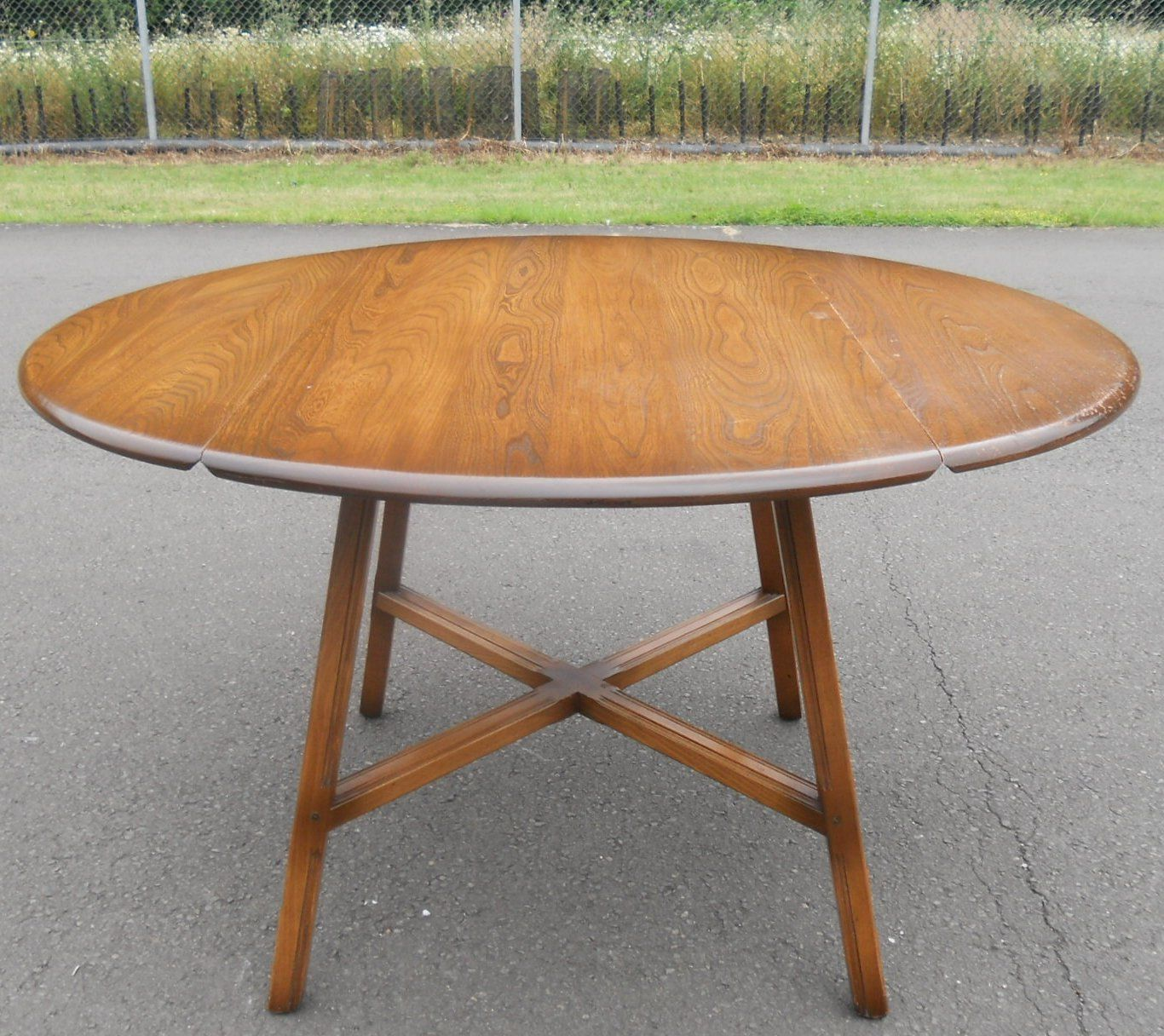 Sold oval dropleaf elm dining table by ercol watchthetrailerfo